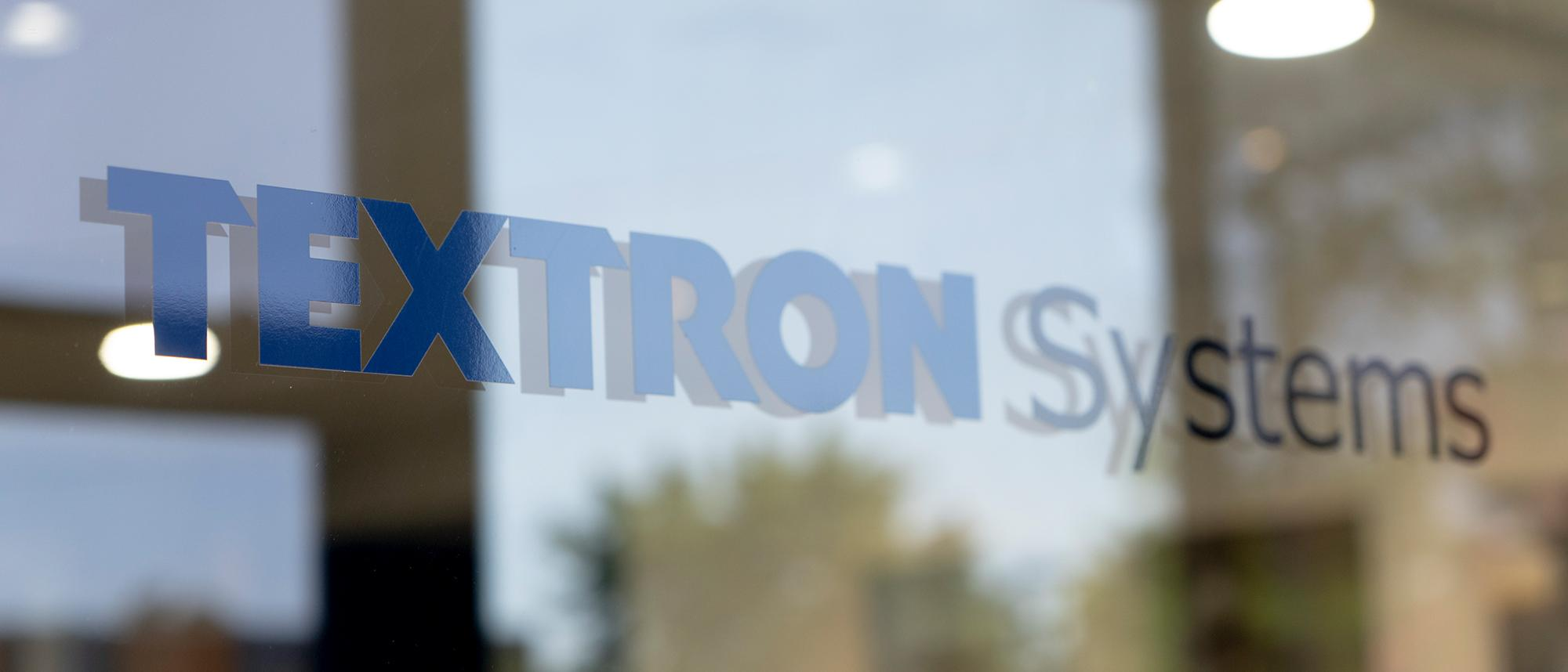 Photo of the Textron Systems Logo Decal on a Window